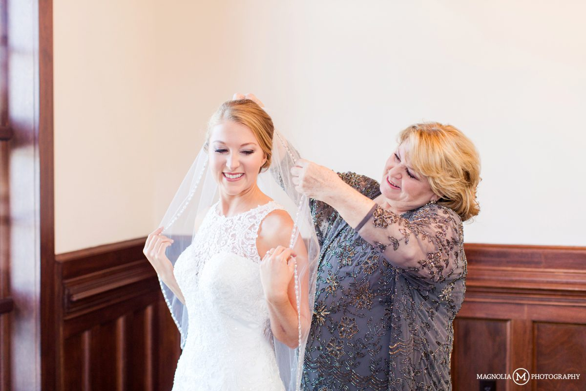 Putting in bride's veil