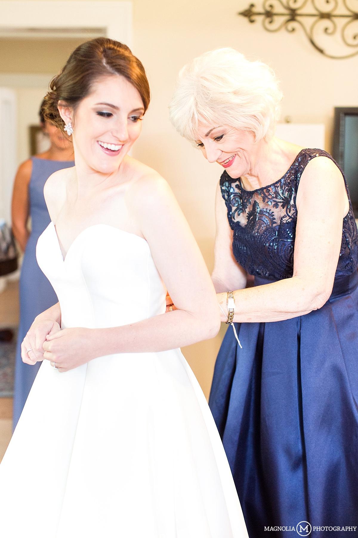 Mom Helping Daughter Into Wedding Dress